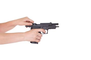 White hand holds gun isolated on white background