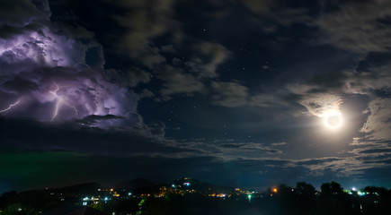 Night sky with thunderstorm, moon and stars