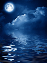 moon with nightly clouds over the water