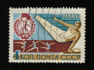 USSR - CIRCA 1965: A stamp printed in the USSR, released to  VIII Spartakiad of Trade Unions, shows a gymnasts and emblem games, circa 1965