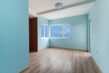 Empty blue room with windows and a door (includes clipping path)