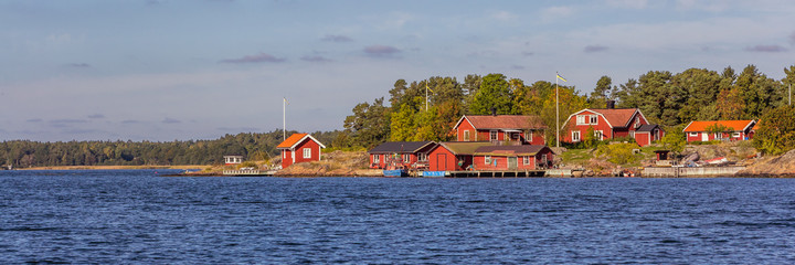 Red cottages on the coast of  south Sweden