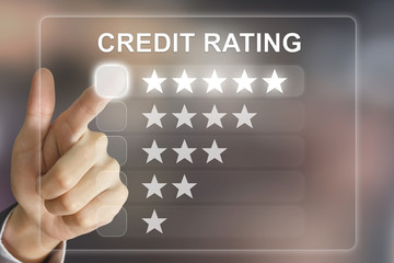 business hand pushing credit rating on virtual screen