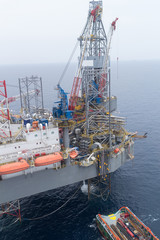 Aerial View of Offshore Jack Up Drilling Rig and Supply Vessel