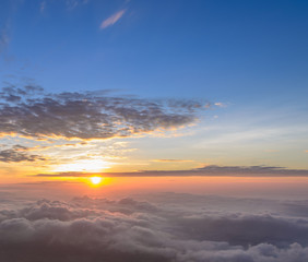Rising sun in the early morning over sea of mist