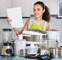 Housewife with kitchen appliances