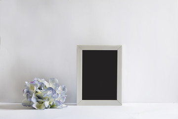 empty picture frame, decorated with blueflowers
