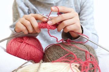 Little child learns to knit. Lifestyle - childhood