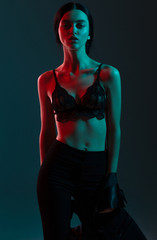 fashion girl red blue light in studio