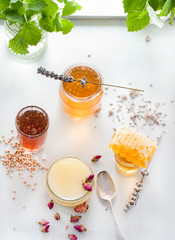 Honey variaty with bee's comb in a glass jurs
