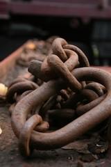 Huge chain links in rail yard