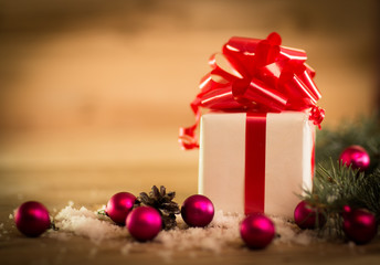 green fir branches on the wooden floor with gifts with Christmas decoration