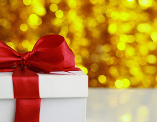 christmas golden gift on a furry background