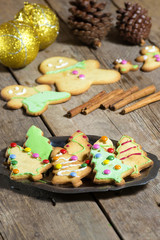 Cookies and Christmas decorations on wooden table