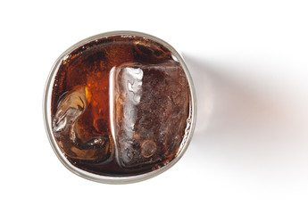 Glass with cola and ice above view