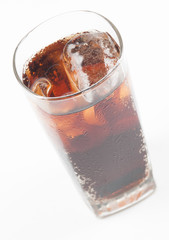 Glass of cola with ice isolated on white.