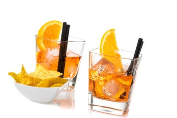 Fototapete - two glasses of spritz aperitif aperol cocktail with orange slices and ice cubes near tacos chips