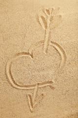 Heart handwritten on a beach sand