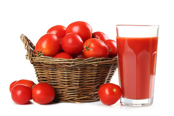 Fresh red tomatoes in basket and tomato juice in glass isolated