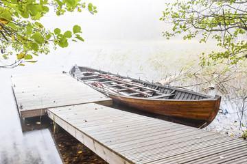 Long wood boat in a mist
