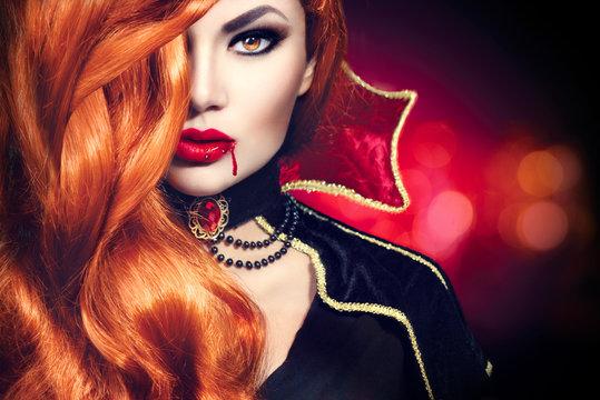 Halloween vampire woman portrait. Beautiful glamour fashion sexy vampire