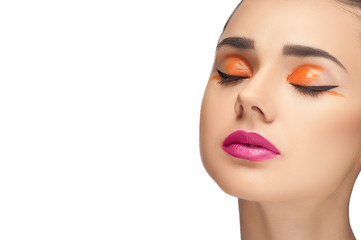 High fashion look, closeup beauty portrait of beautiful young woman model with bright makeup, perfect clean skin and colorful red pink lips and orange eyeshadow.