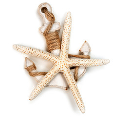 wooden anchor and sea star isolated on white background