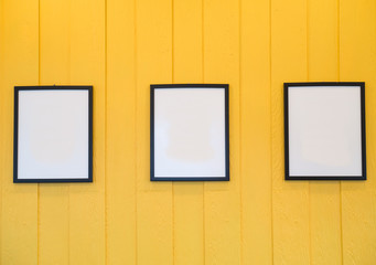 Three frames on yellow background