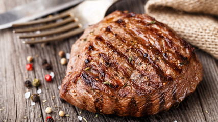 Poster de jardin Steakhouse Beef steak on a wooden board
