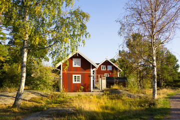 Red cottages on the island Harstena in Sweden, principally known