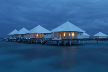 Maldives water villa sunset