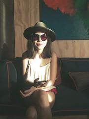 smile woman sit on sofa