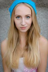 The beautiful girl in a blue cap on walk