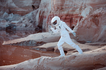 Water on Mars, futuristic astronaut, image with the effect of