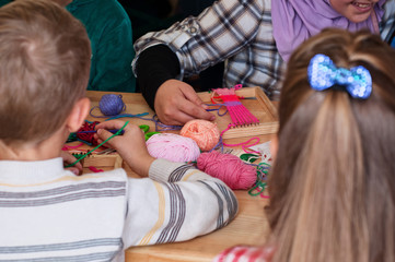 Grupa children learn to weave