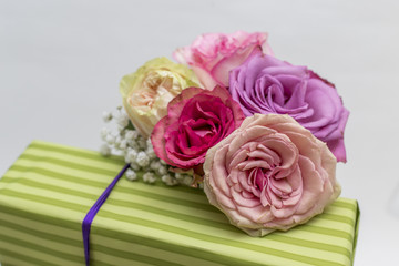 Closeup of fresh roses on present box