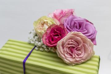 Closeup of fresh roses on present box
