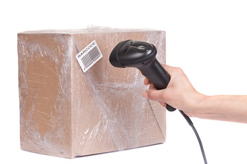 Wall Mural - Closeup of the barcode scanner during scanning of boxes of goods