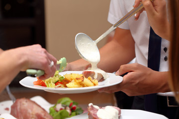 Chef serves portions of food at a party