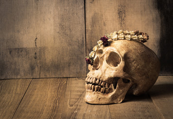 human skull and garland jasmine still life