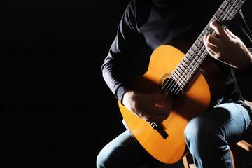 Acoustic guitar guitarist hands close up