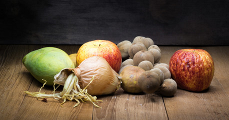 fruit still life on wooden board light painting
