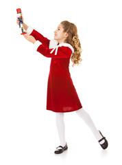Christmas: Little Girl Strikes a Pose With Nutcracker