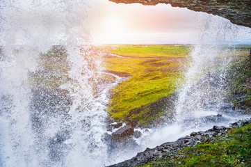 Beautiful view from inside the waterfall, Iceland Wall mural