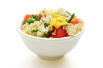 chinese cuisine - homemade fried rice with tomatoes and egg on white with clipping path