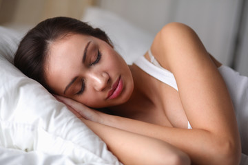 Pretty woman lying  in bed at home