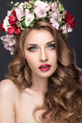 beautiful blond girl with curls and wreath of purple flowers on