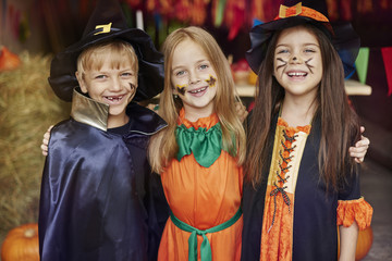 Cheerful children with Halloween face paint