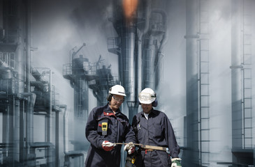 oil and gas industry with two workers, slight zoom on the background
