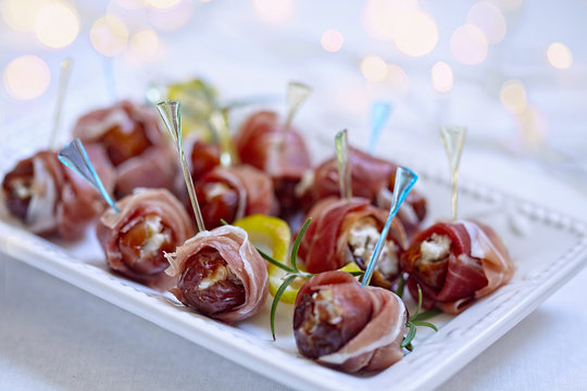 Dates stuffed cheese and wrapped prosciutto